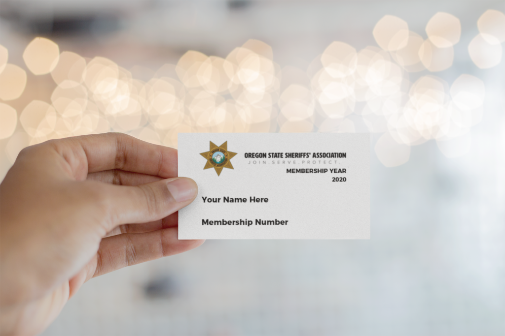 mockup-of-a-business-card-being-held-against-blurred-lights-21915-1