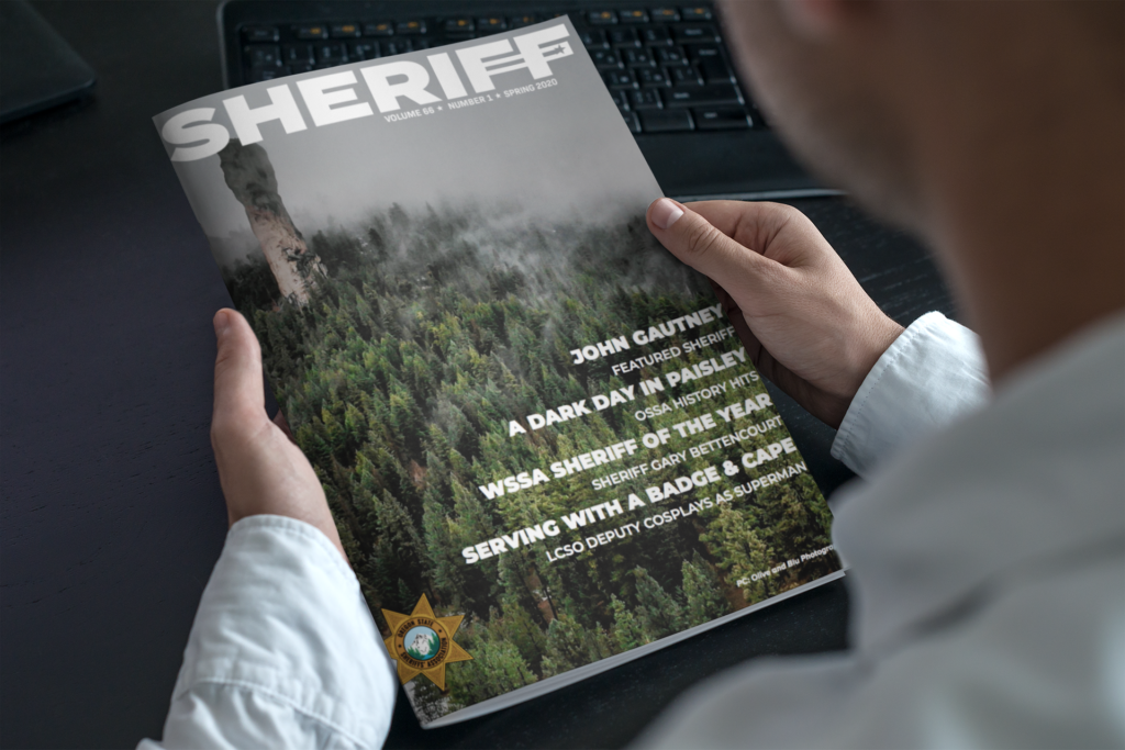 mockup-of-a-magazine-in-the-hands-of-a-man-with-a-blue-shirt-3384-el1-1